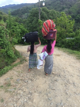 Abelina and Bertha carrying my luggage and stuff
